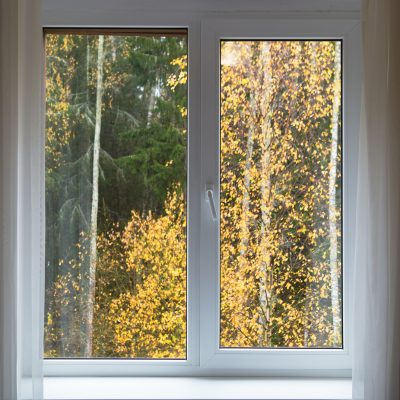 White window with sill and autumn landscape, interior with window in autumn day.
