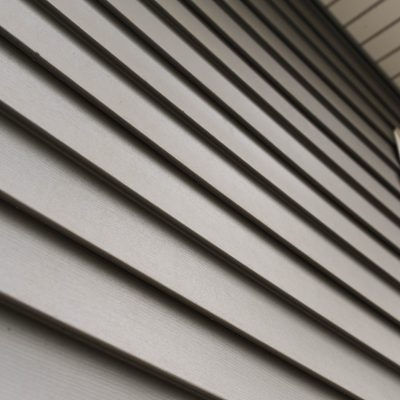 Close,Up,Look,At,Vinyl,Siding,On,A,New,Home.